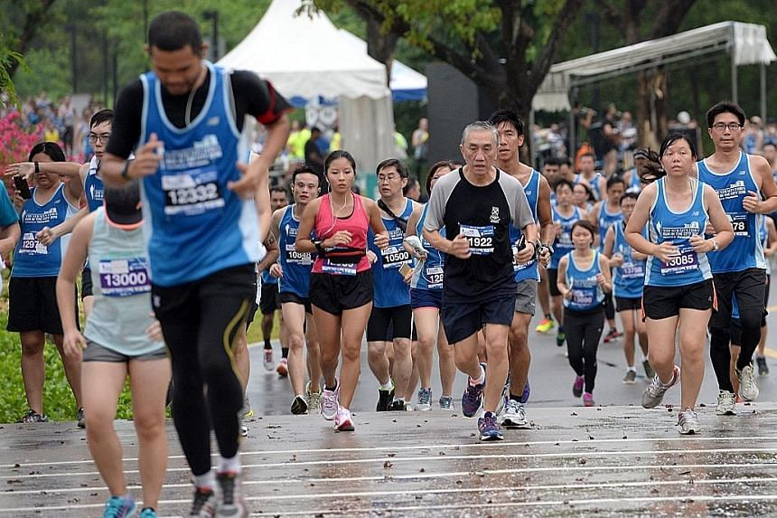 Participants at last year's ST Run in the City. This year's run on July 16 will end at the Padang.