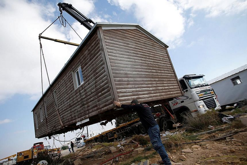 A pre-fabricated home being removed from the illegal Israeli settler outpost of Amona in the West Bank in February. Israel plans to build a new settlement as compensation for the 40 Amona families evicted.