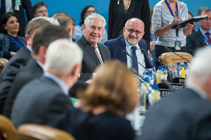 Mr Rex Tillerson (centre) at the Nato foreign ministers' meeting in Brussels yesterday, where he sought to assuage fears that the US administration would seek closer ties with Russia at Nato's expense.