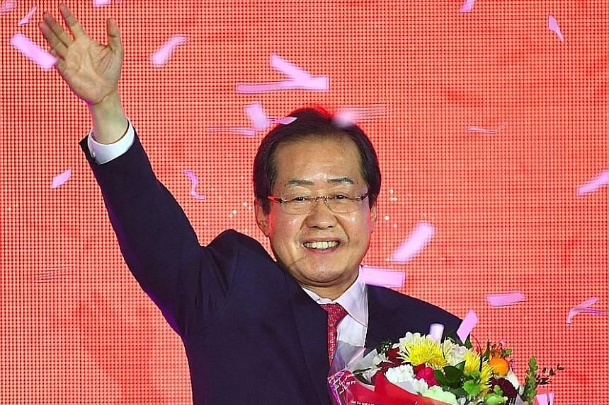 Mr Hong at yesterday's convention where he was named the Liberty Korea Party's presidential candidate.