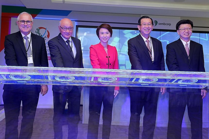 Ms Low with (from left) Sembcorp Industries' Mr Neil McGregor, non-executive and non-independent director and chief executive-designate; Mr Ang Kong Hua, chairman; Mr Tang Kin Fei, group president and CEO; and Mr Ng Meng Poh, executive vice-president
