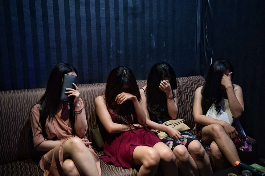Hostesses at a KTV bar on Sam Leong Road during a police raid in the early hours of Saturday (April 1).