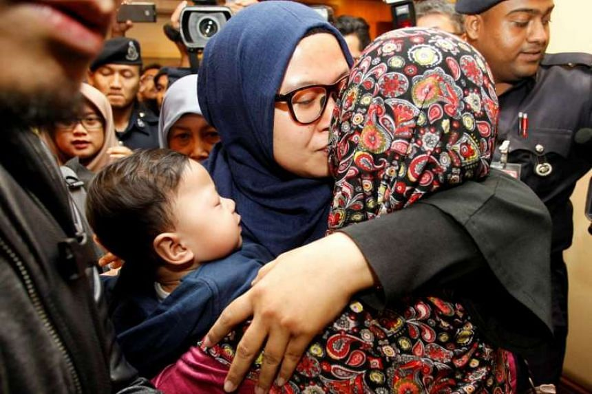 One of the nine Malaysians who were previously stranded in Pyongyang hugs a family member as he returns home from Pyongyang, at the Kuala Lumpur International Airport, on March 31, 2017.