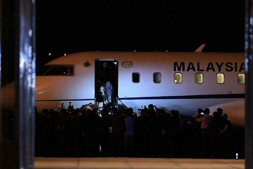 Returning Malaysian nationals from Pyongyang disembarking from the plane at the Bunga Raya complex at the Kuala Lumpur International Airport, on March 31, 2017.