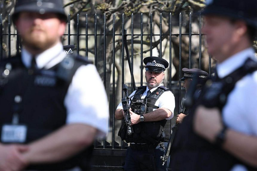 Police stand guard outside of the parliament in London, Britain, 30 March 2017.