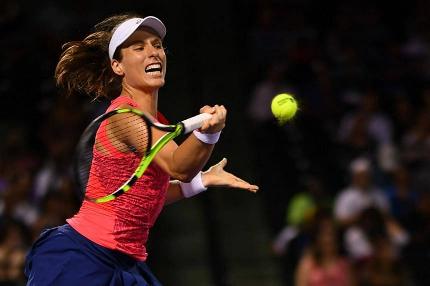 Johanna Konta of Great Britain in action during the semi-finals match against Venus Williams on day 11 of the Miami Open at the Crandon Park Tennis Center on March 30, 2017 in Key Biscayne, Florida.