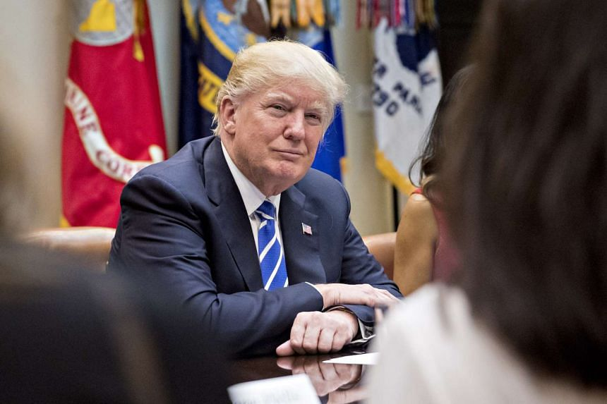 US President Donald Trump listening while meeting with business owners in the Roosevelt Room of the White House in Washington, DC, on March 27, 2017.