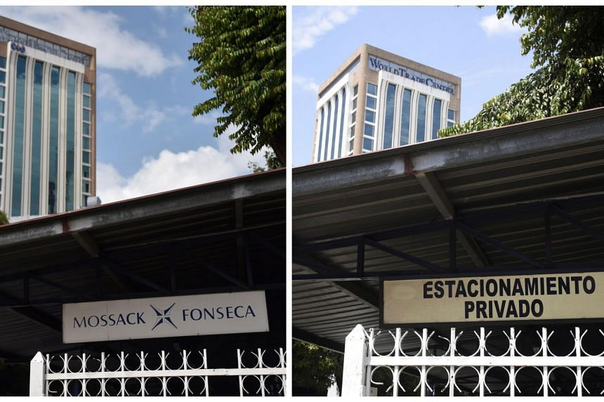 This photo composition shows a sign outside the building where Panama-based Mossack Fonseca law firm offices are located on April 4, 2016 (left) and March 30, 2017 in Panama City.