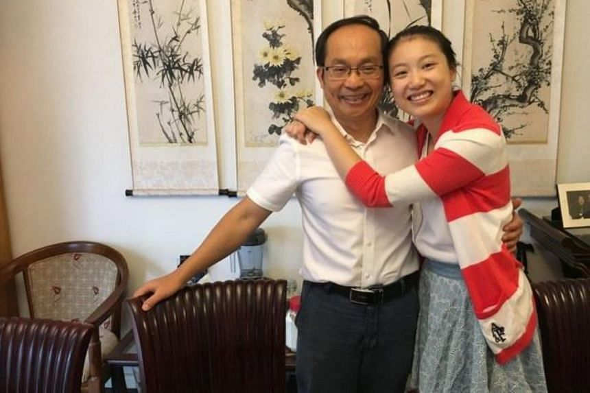 Australia-based academic Feng Chongyi (left) arrived home in Sydney on Sunday (April 2), vowing to return to the mainland later this year to complete his research.