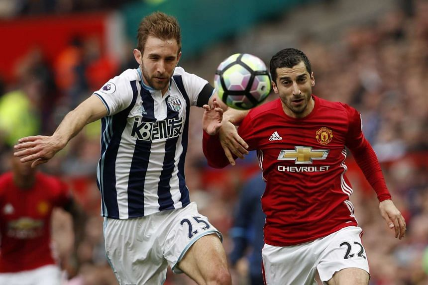 West Bromwich Albion's Craig Dawson in action with Manchester United's Henrikh Mkhitaryan.