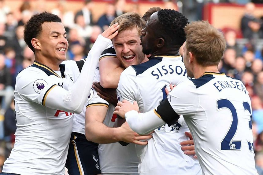 Tottenham's Eric Dier celebrates scoring their first goal with team-mates.