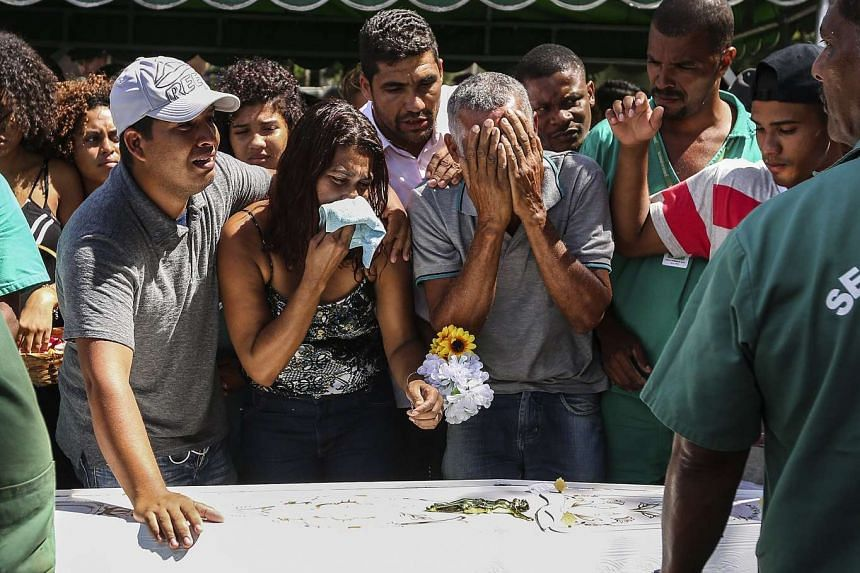 Relatives and friends of María Eduarda Alves attend her funeral in a cemetery in Rio de Janeiro.