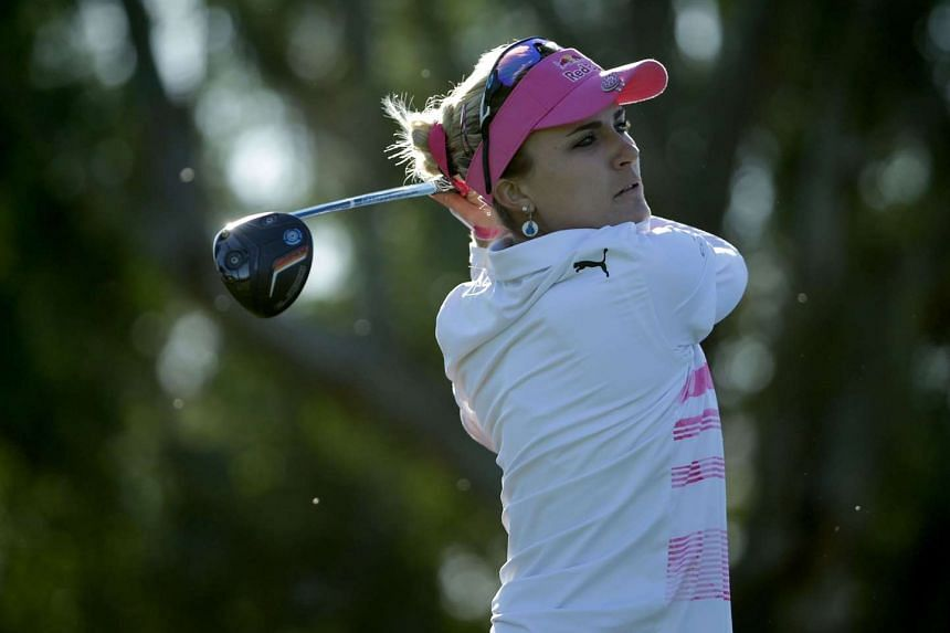 Lexi Thompson plays her tee shot on the third hole during the completion of the second round.