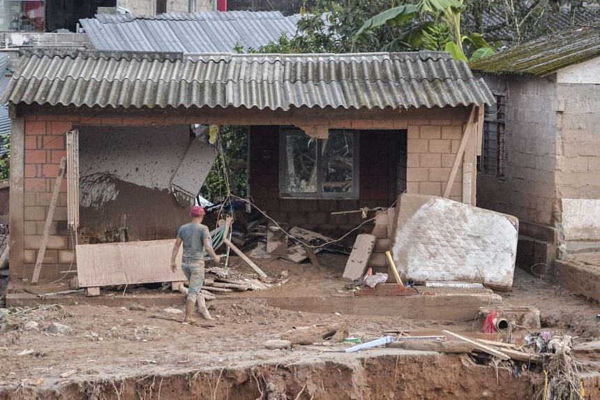 A man walks through the rubble left by mudslides following heavy rains in Mocoa, Putumayo department, southern Colombia on April 1, 2017.