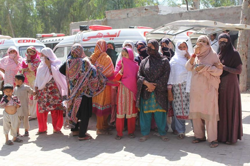 Relatives wait to receive the bodies of the victims.