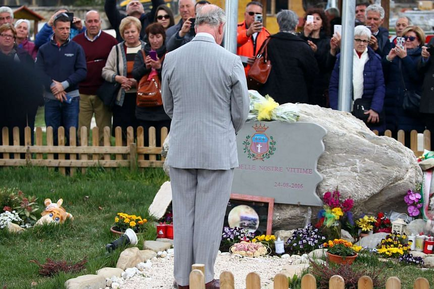 Prince Charles pays his respects to the victims of the earthquake in the town of Amatrice.