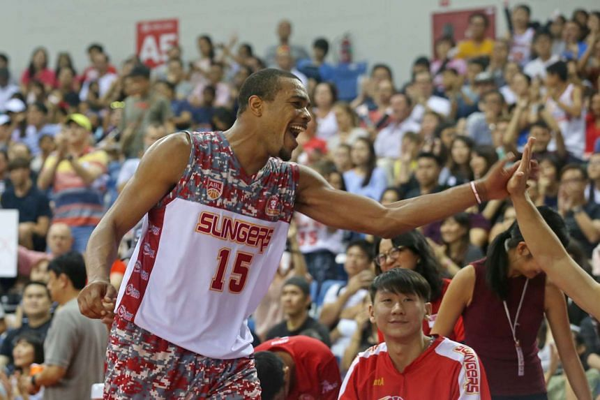 Singapore Slingers forward Xavier Alexander acknowledges his teammates after finishing as the top scorer with 24 points.
