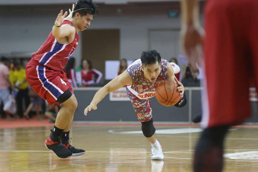 Singapore Slingers guard Wong Wei Long maintains his balance as he dribbles the ball.