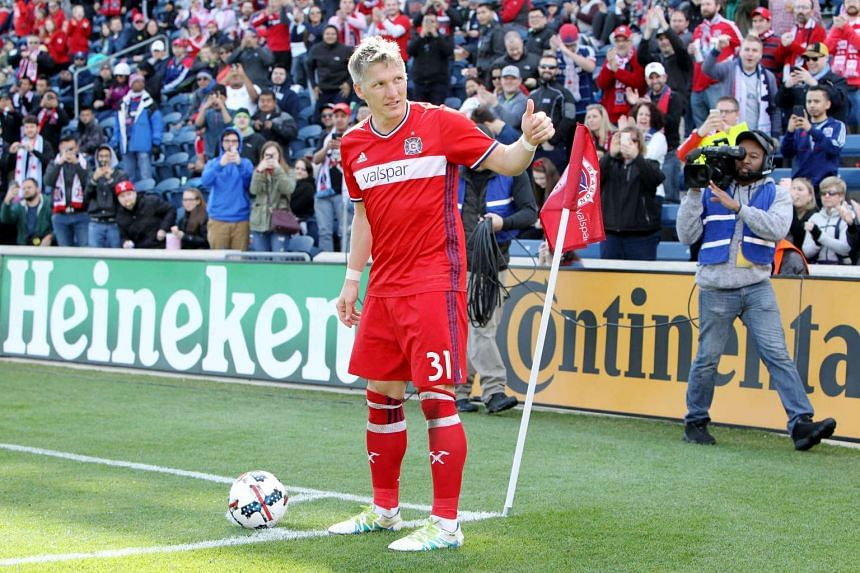 Bastian Schweinsteiger acknowledges the crowd before taking a corner kick in the second half against the Montreal Impact during an MLS match at Toyota Park on April 1, 2017.