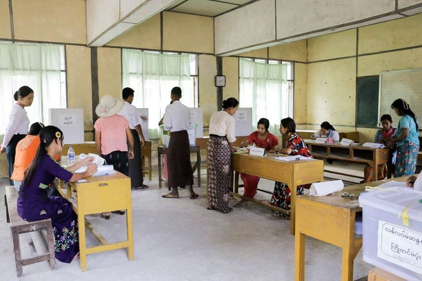 People cast their votes at a polling station for by-elections in Kawhmu Township in Yangon, Myanmar, on April 1, 2017.