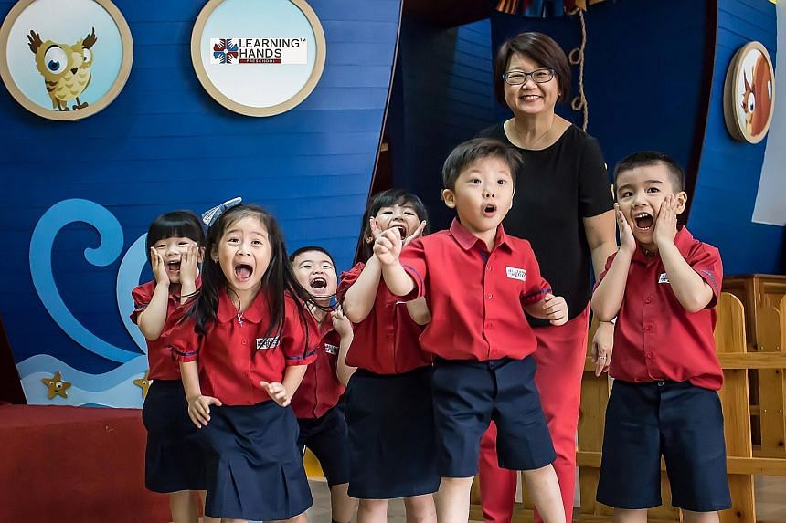 Ms Tan with children at the Learning Hands pre-school she runs in North Jakarta. It offers a Singapore-style curriculum to middle-class Indonesians, who pay $4,000 a year in school fees.