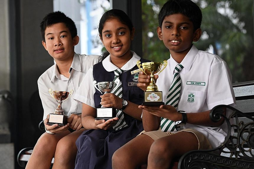 Lee I Shiang (left), 12, of Rosyth School, beat Clarissa Ella Ng Yen, 11, of Methodist Girls' School, to third place in Group A.