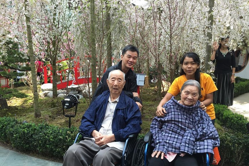 The writer with his parents and their helper, Menti, had a nice break enjoying the cherry blossoms at Gardens by the Bay recently. Mr Goh says that without Menti, it would have been impossible for his parents to continue living in their own home, sur