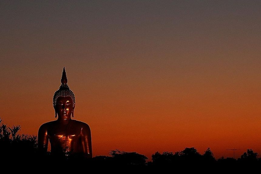 Mr Xi was a pragmatist, but evidence also points to his being motivated by genuine respect for traditional Chinese faiths, says the writer. A Buddha statue in Ang Thong, Thailand. Mr Xi and the late Shi Youming forged an unusual alliance in the 1980s
