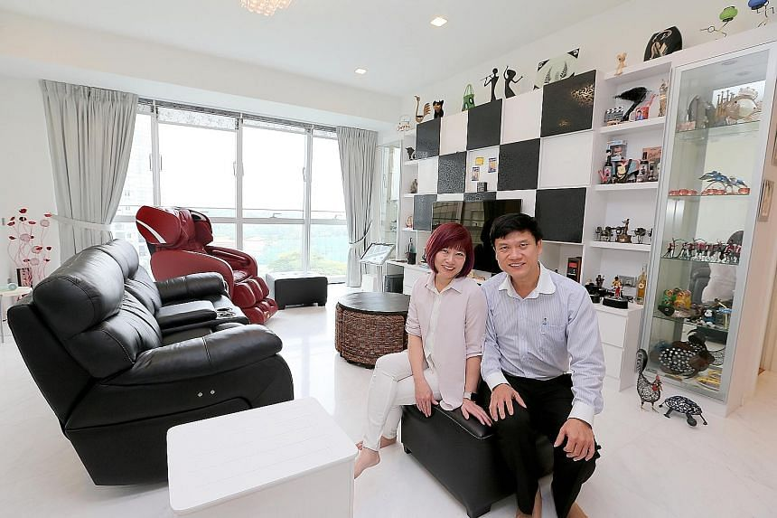 Mr Poh and his wife Linda in their Keppel Bay condo. The bright sunshine streaming in adds to the sense of spaciousness in the living area, which is filled with souvenirs gathered on Mr Poh's travels around the globe.