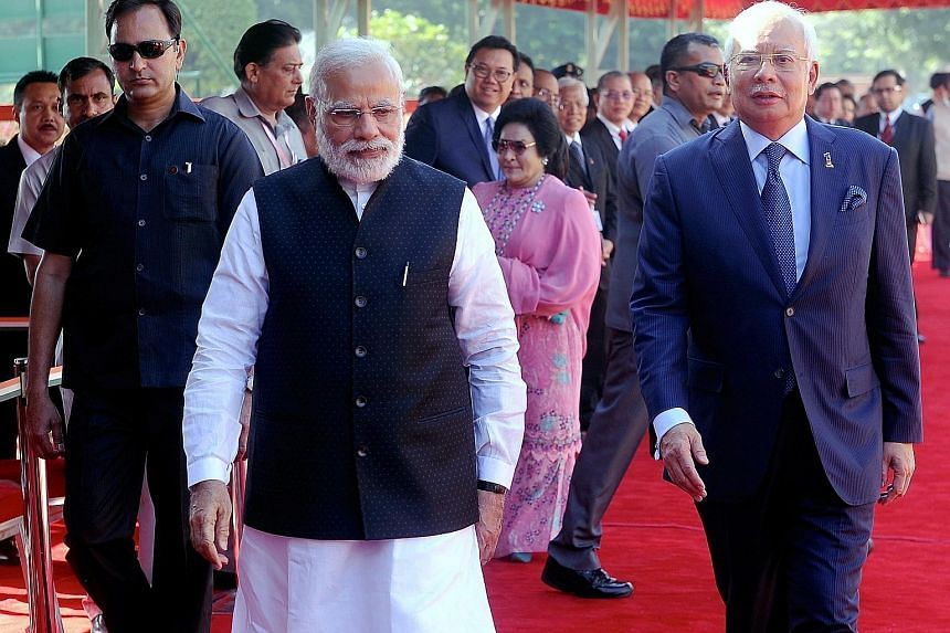 Mr Najib Razak was hosted by Mr Narendra Modi at an official welcome at Rashtrapati Bhavan Presidential Palace. This is his third visit to India since he took office in 2009. His busy schedule in the six-day visit includes holding talks with business