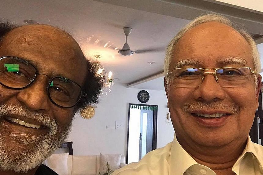 Mr Najib posing for a photo with Mr Rajinikanth at the latter's home.