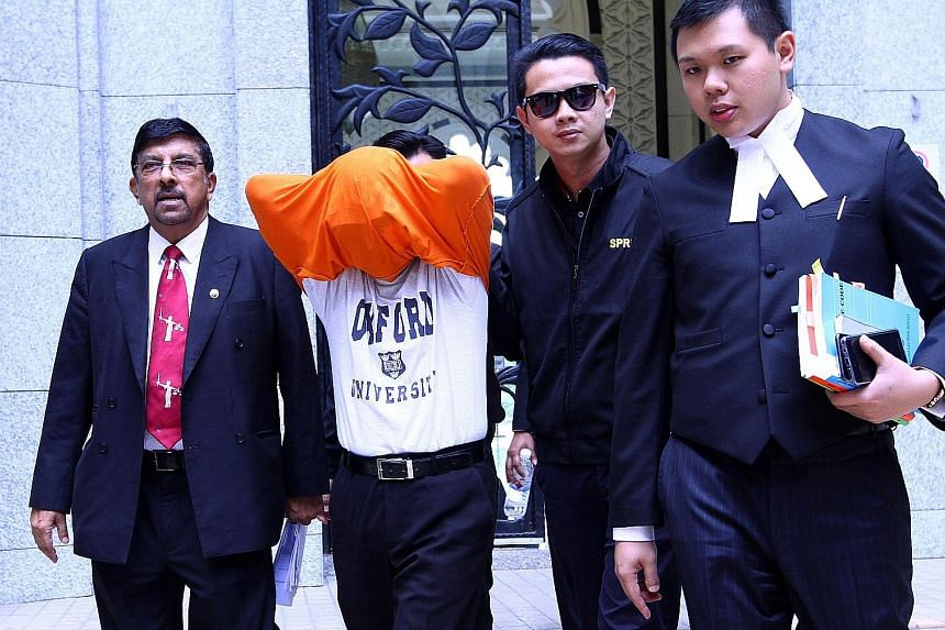 The businessman leaving the court in Putrajaya with two of his lawyers, Datuk K. Kumaraendran and Mr J.R. Tey, and a Malaysian Anti-Corruption Commission officer.