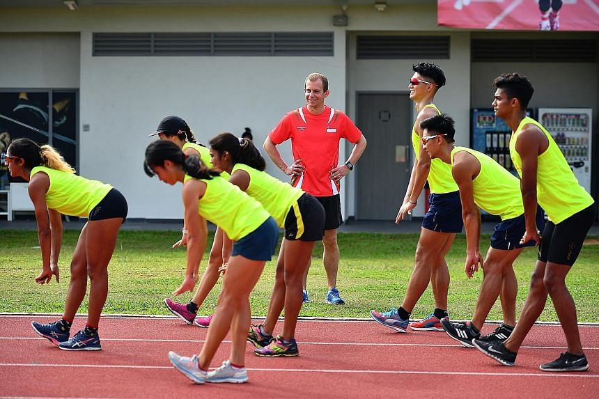 Volker Herrmann looking on yesterday during a training session for the national team at the Kallang Practice Track. The new Singapore Athletics technical director quickly identified areas of improvement for the athletes.