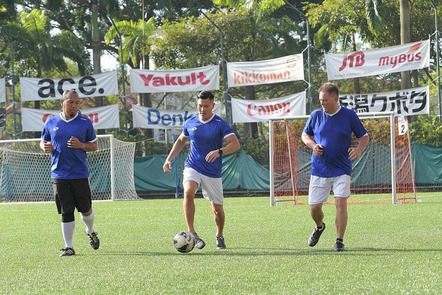 From left: Football dads Irwan Isnin, Newton Zheng and Peter Mathe having a kickabout.