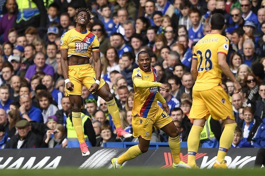 Joy for Crystal Palace's (from left) Wilfried Zaha as he celebrates his equaliser against league leaders Chelsea with Jason Puncheon and Luka Milivojevic.