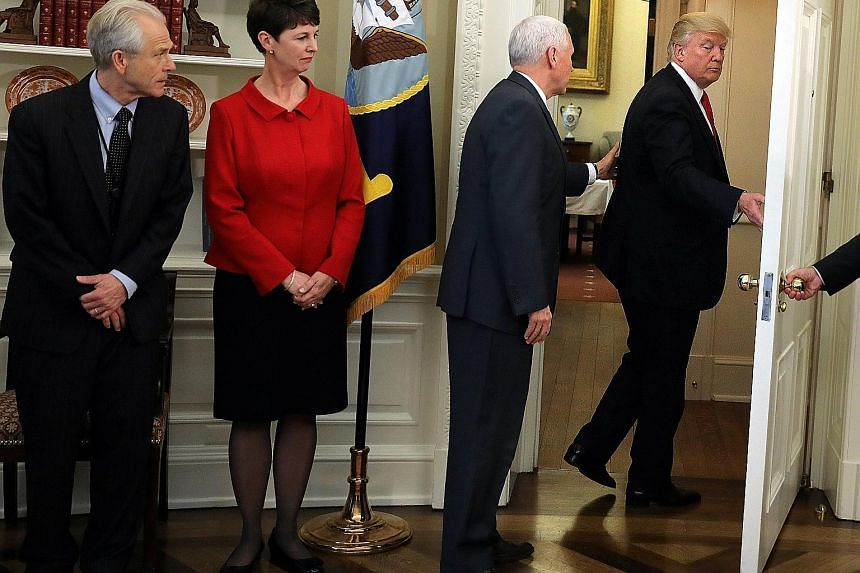 United States President Donald Trump leaving the Oval Office last Friday without signing the two executive orders on trade, after reporters asked about former national security adviser Michael Flynn and Russia's alleged involvement in the US election