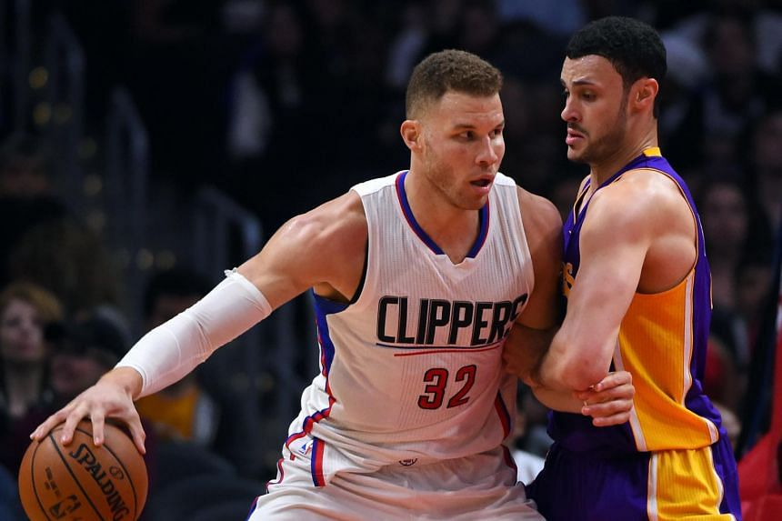 LA Lakers forward Larry Nance Jr. (right) defends Clippers forward Blake Griffin in the second half of the game.