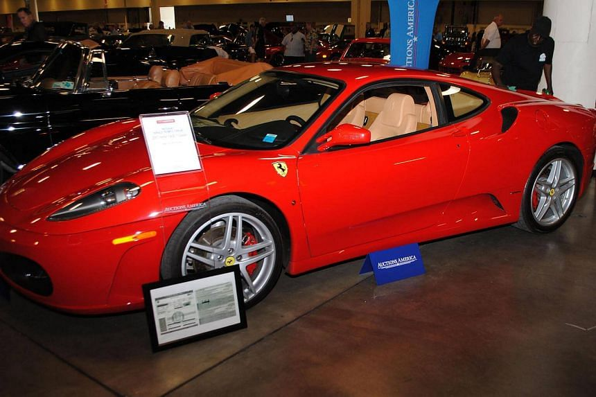 A Ferrari F430 owned by US president Donald Trump in 2007 is exhibited by Auctions America in Fort Lauderdale, Florida.