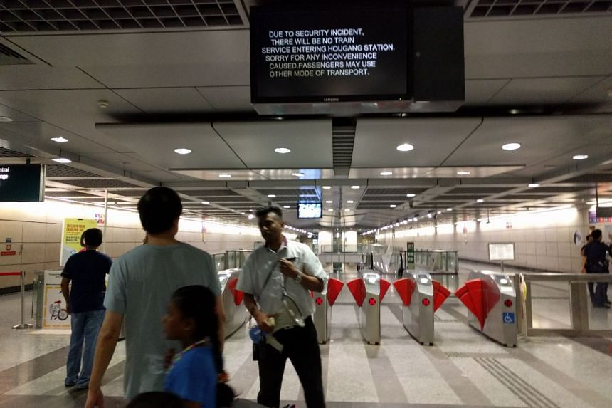 """SBS Transit staff telling commuters to leave Hougang Station, after a """"security incident"""" was reported, on April 2, 2017."""