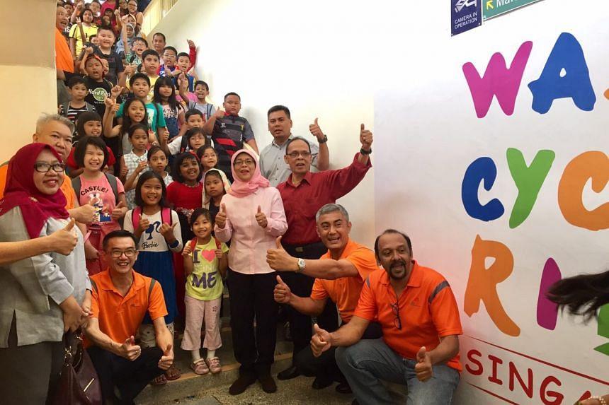 Speaker of Parliament and MP for Marsiling-Yew Tee GRC (Marsiling) Halimah Yacob (centre, in pink) officiated the adoption of a 44-year-old underpass along Admiralty Road.