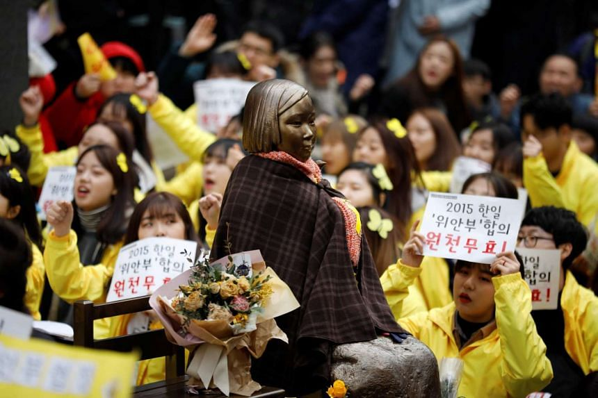 """A statue symbolising former South Korean """"comfort women"""" at an anti-Japan rally in Seoul on March 1, 2017."""