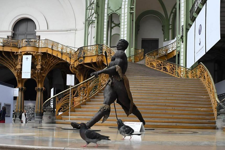 Senegalese artist Ousmane Sow's sculpture Le Lanceur at the Art Paris Art Fair exhibition the Grand Palais in Paris. Exhibitors were packing up when one person distracted the seller and another made off with a box of jewels.