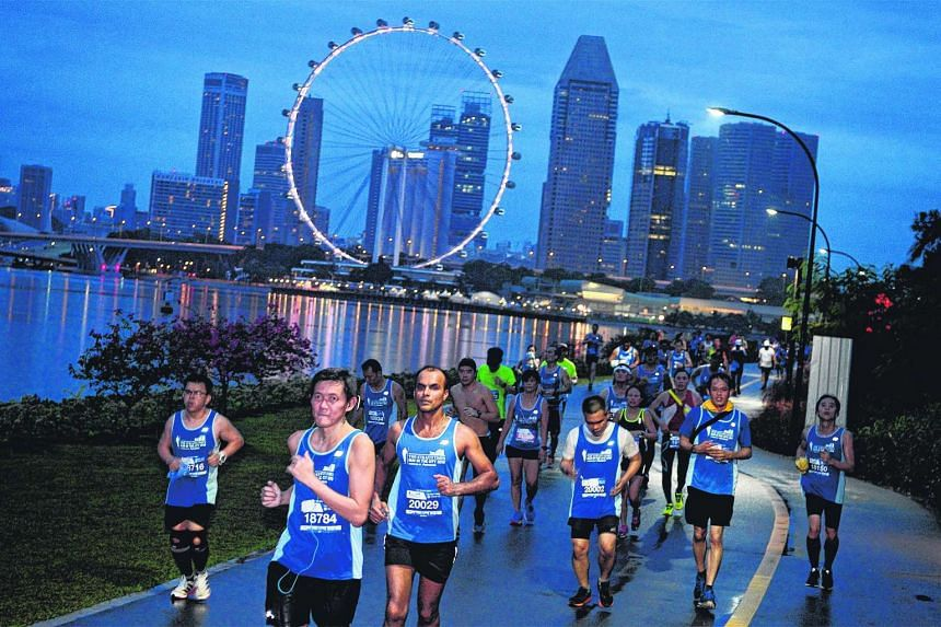 ST Run participants running along Gardens by the Bay East early in the morning on May 22, 2016.