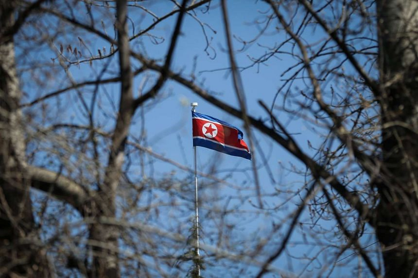The North Korean flag is seen flying at the North Korean embassy in Beijing. China is North Korea's last-remaining major ally and a key provider of food and fuel supplies.