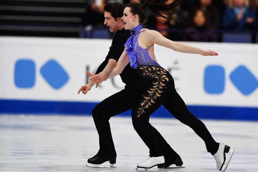 Tessa Virtue and Scott Moir of Canada perform during the short dance, ice dance program of the ISU World Figure Skating Championships 2017 in Helsinki March 31, 2017.