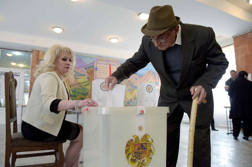 A man casts his ballot at a polling station in Yerevan on April 2, 2017.