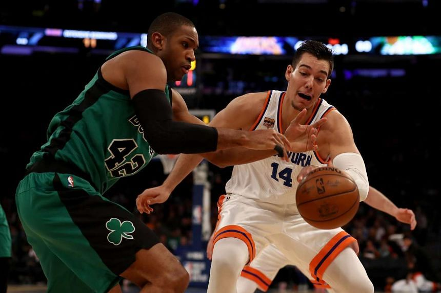 Al Horford of the Boston Celtics loses the ball as Willy Hernangomez of the New York Knicks defends at Madison Square Garden in New York City on April 2, 2017.