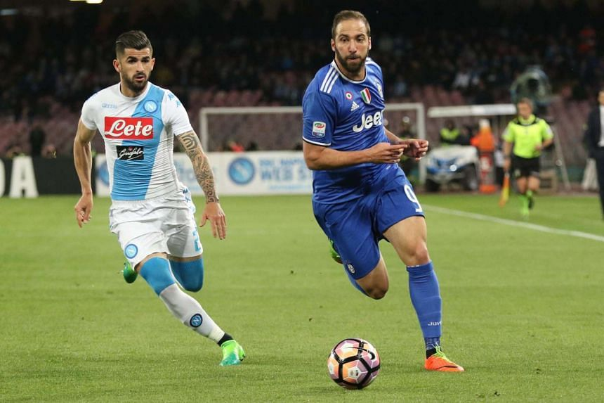Napoli defender Elseid Hysaj (left) and Juve's forward Gonzalo Higuain in action during the Italian Serie A match on April 2, 2017.