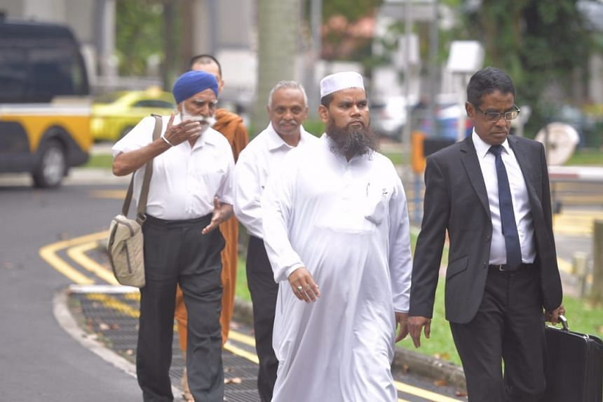 Imam Nalla Mohamed Abdul Jameel, accompanied by religious leaders, outside the State Courts on April 3, 2017.