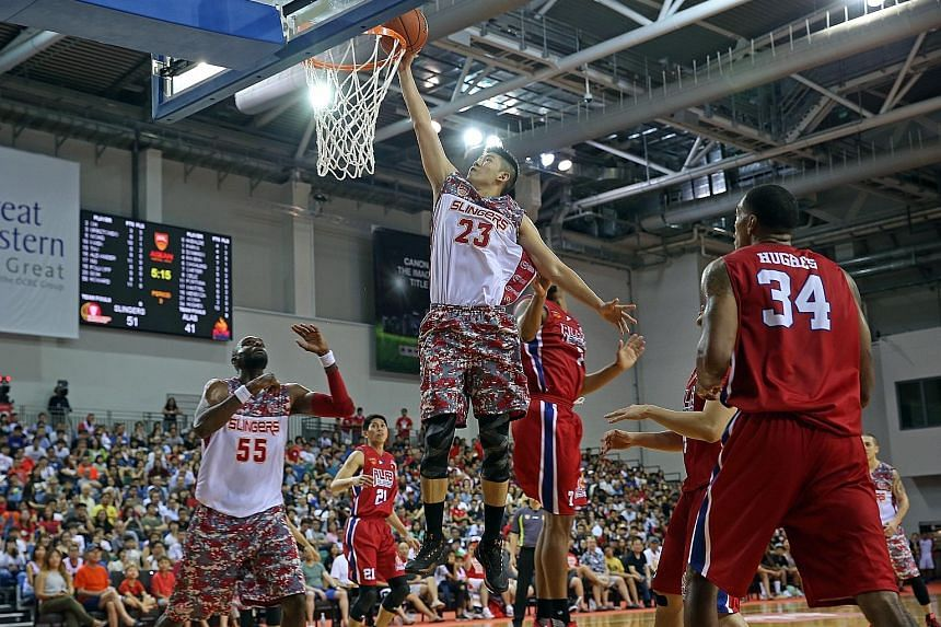 Slingers centre Delvin Goh going up for a basket, as Justin Howard awaits the rebound in Game One of the best-of-three semi-finals against Alab Plipinas. The Slingers won 77-67, with Game Two in Bulacan on Friday night.